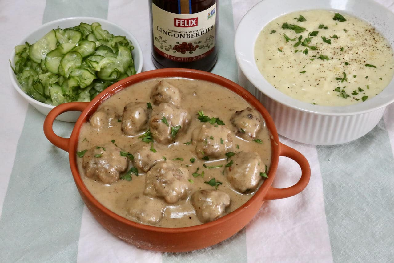 Serve traditional Köttbullar with mashed potatoes, lingonberry jam and quick pickled cucumbers.