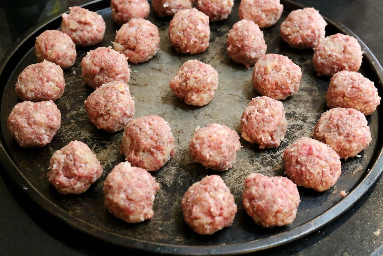 Rest Köttbullar Swedish Meatballs on a baking tray until ready to fry.