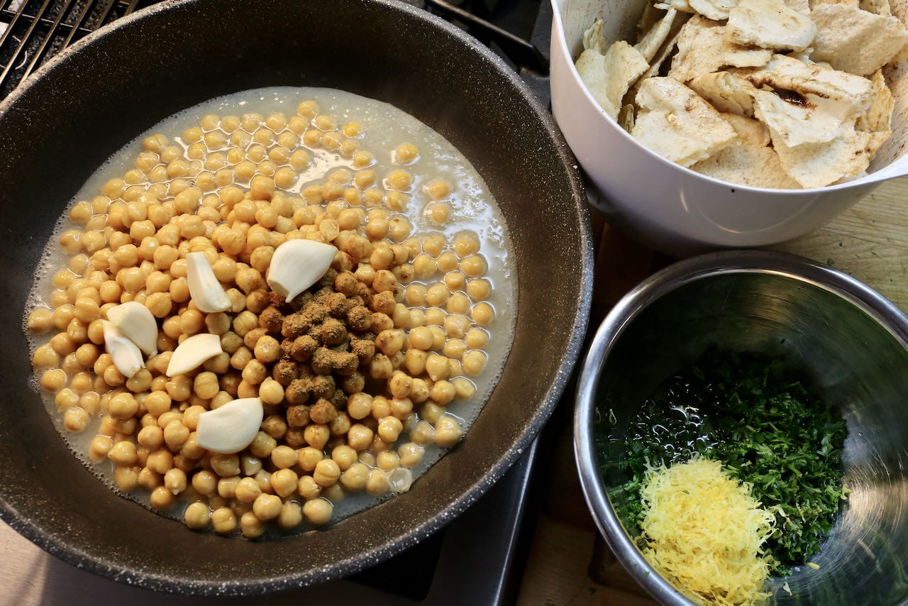 Eggplant Fatteh Components: spiced chickpeas, torn pita, parsley and lemon.