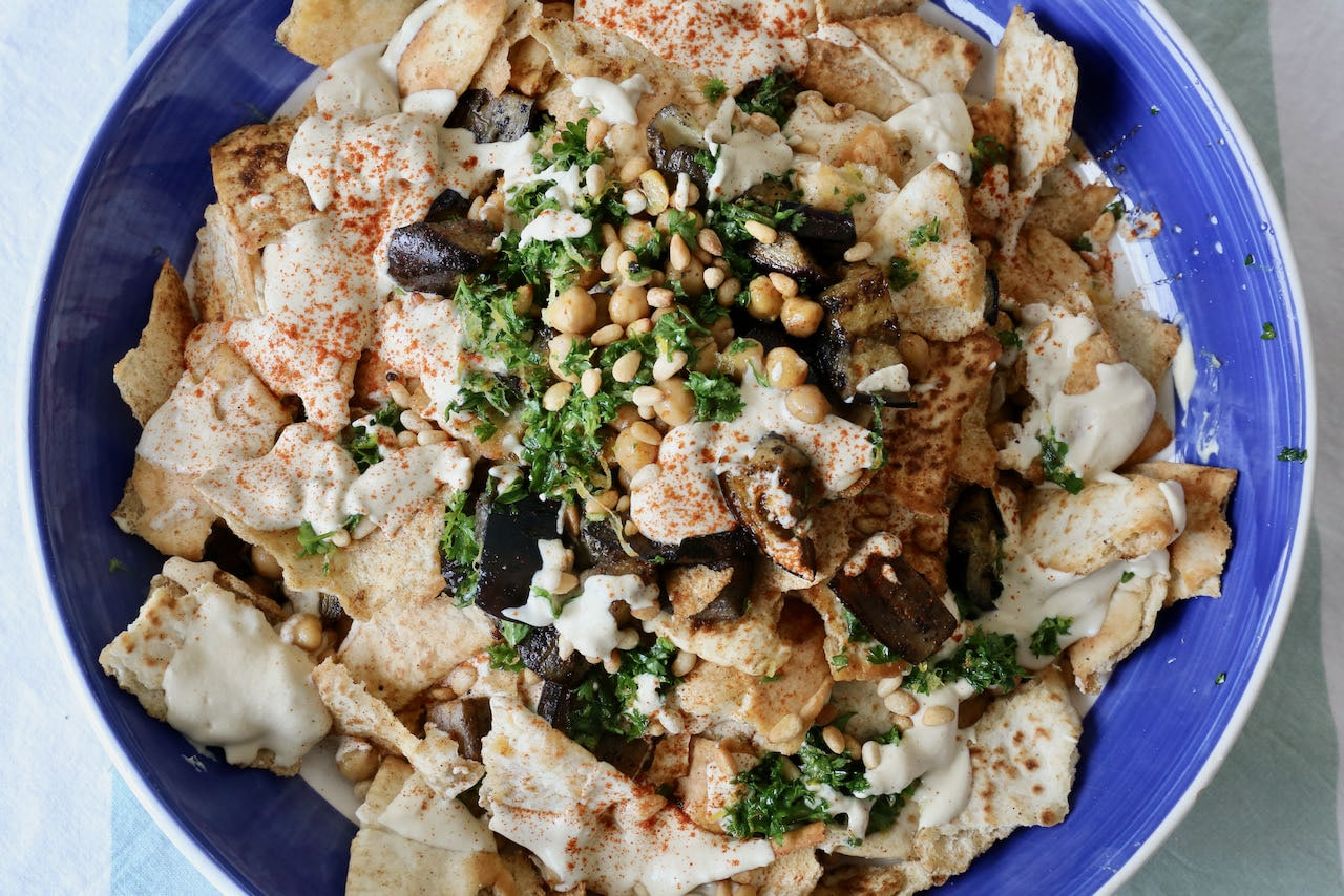 Serve homemade healthy vegetarian Eggplant Fatteh in a large salad bowl or casserole dish.