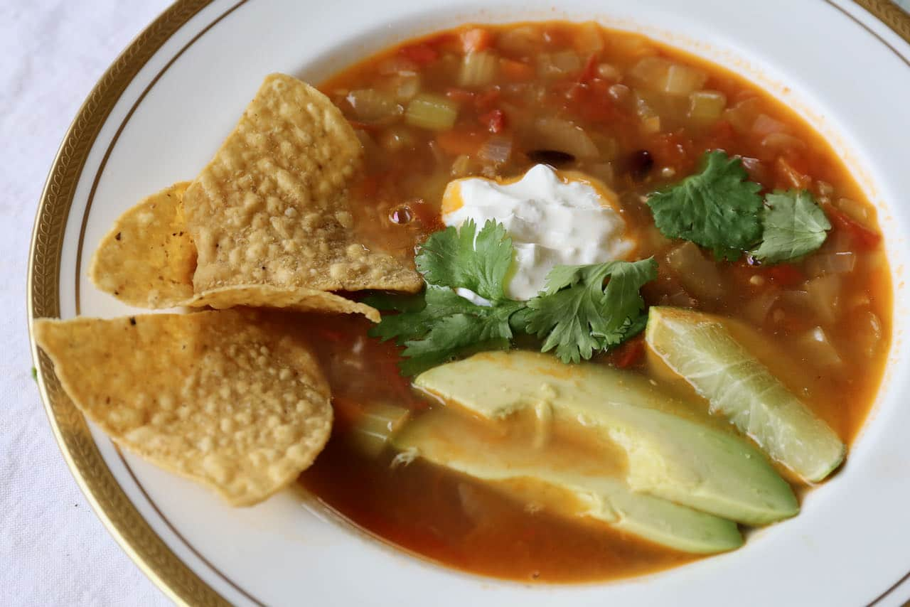 Serve Mexican Bean Soup with crunchy nachos, salsa and guacamole for a healthy lunch or dinner idea.
