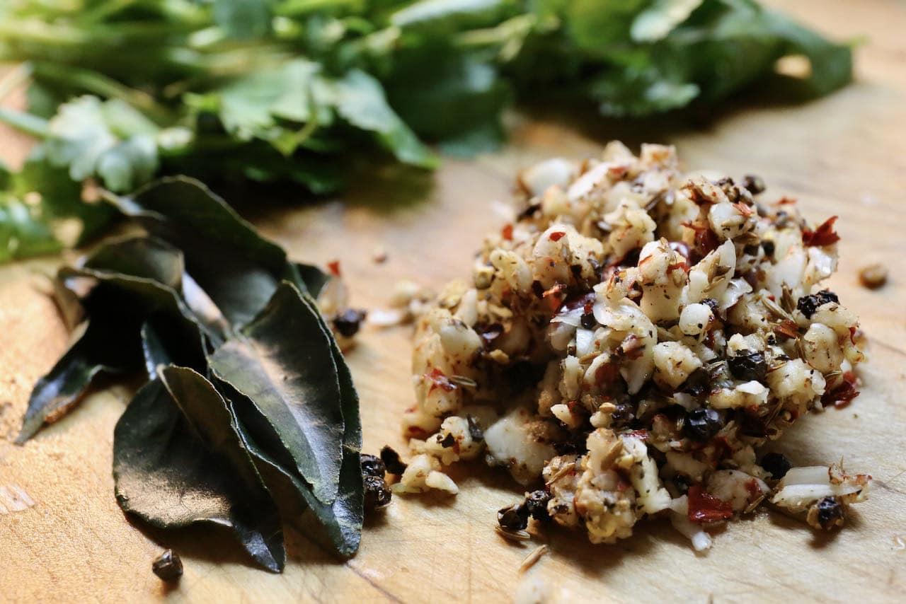 Use a grinder or blender to prepare Milagu Rasam garlic spice mix.