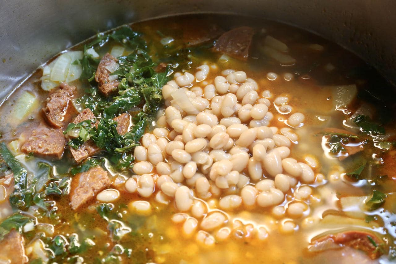 Add navy beans and chorizo and cook until tender.