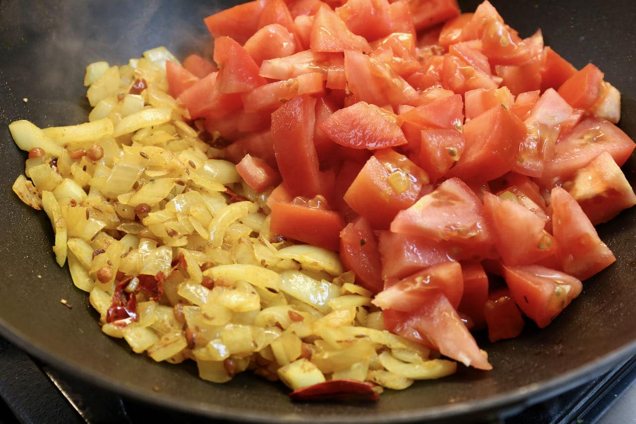 Tomato Chutney For Dosa: Stir in sliced tomatoes and cook until softened.