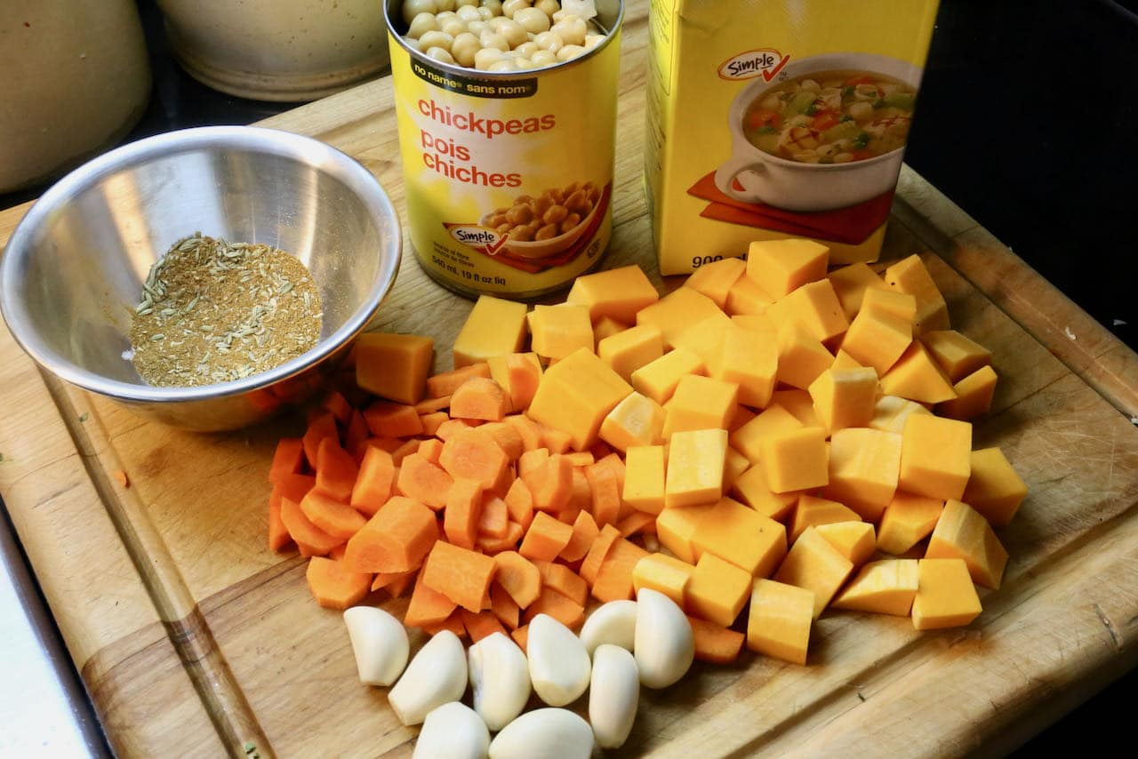 Prepare spice mix and chop carrots and squash.