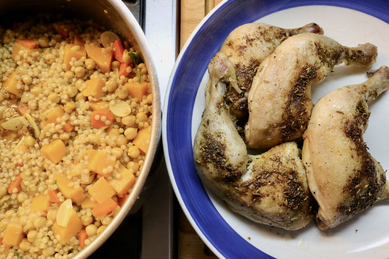 Moghrabieh is made up of Lebanese couscous and roasted chicken legs.