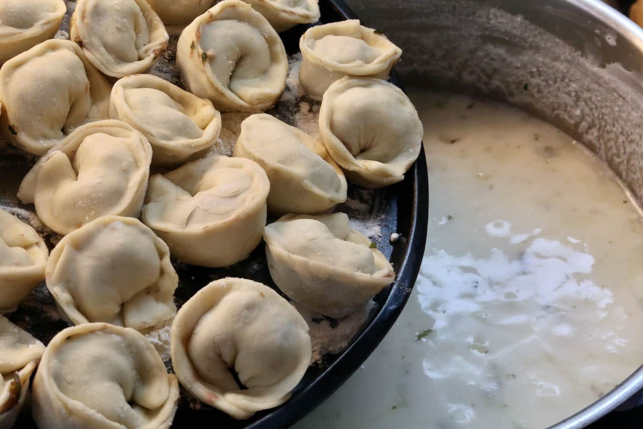 Cook Lamb Dumplings in a creamy and tangy yogurt sauce.