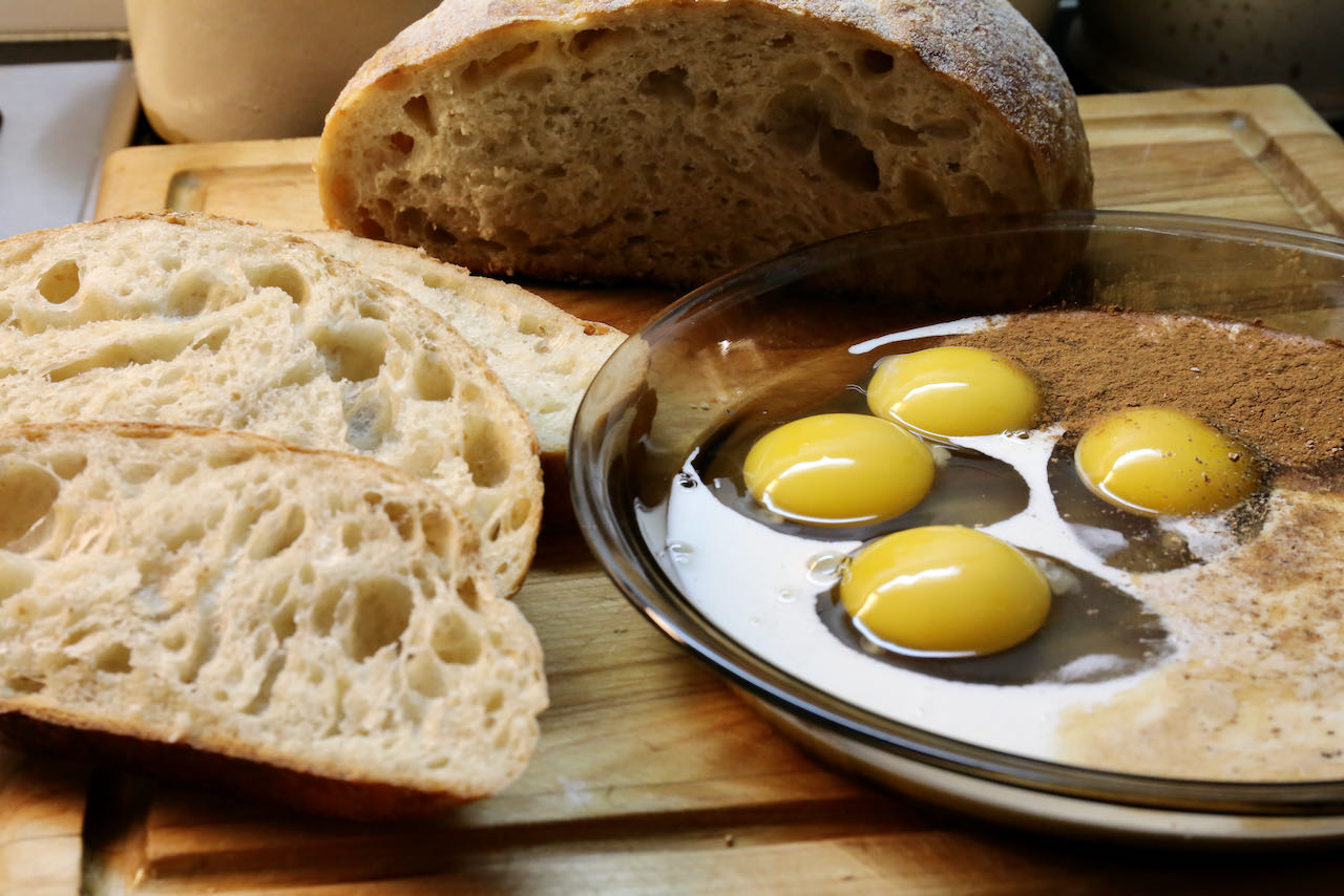 Soak thick slices of sourdough bread into a shallow dish filled with eggs, cream, milk and spices.