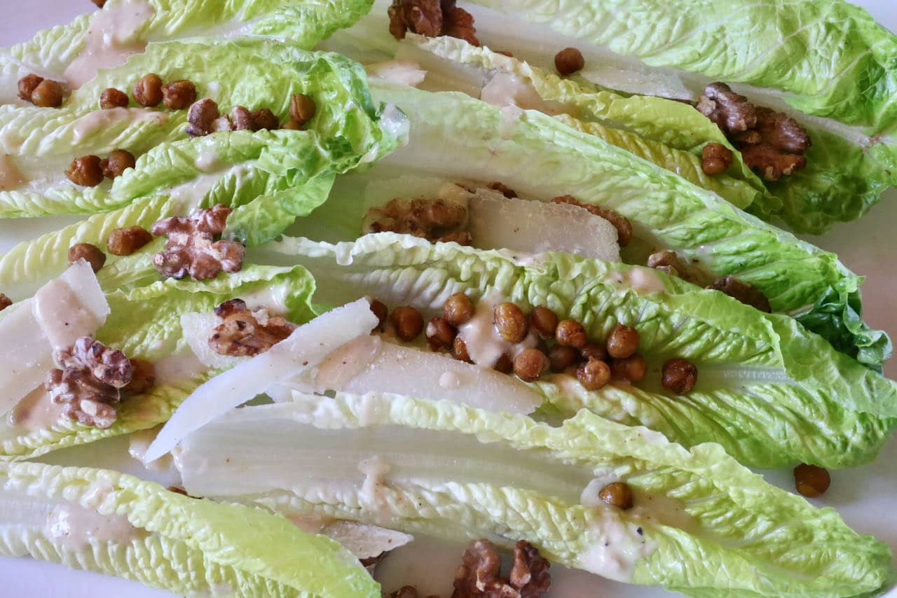 If you're hosting a dinner party arrange whole Romaine leaves on a serving platter and drizzle with Tahini Caesar Dressing.