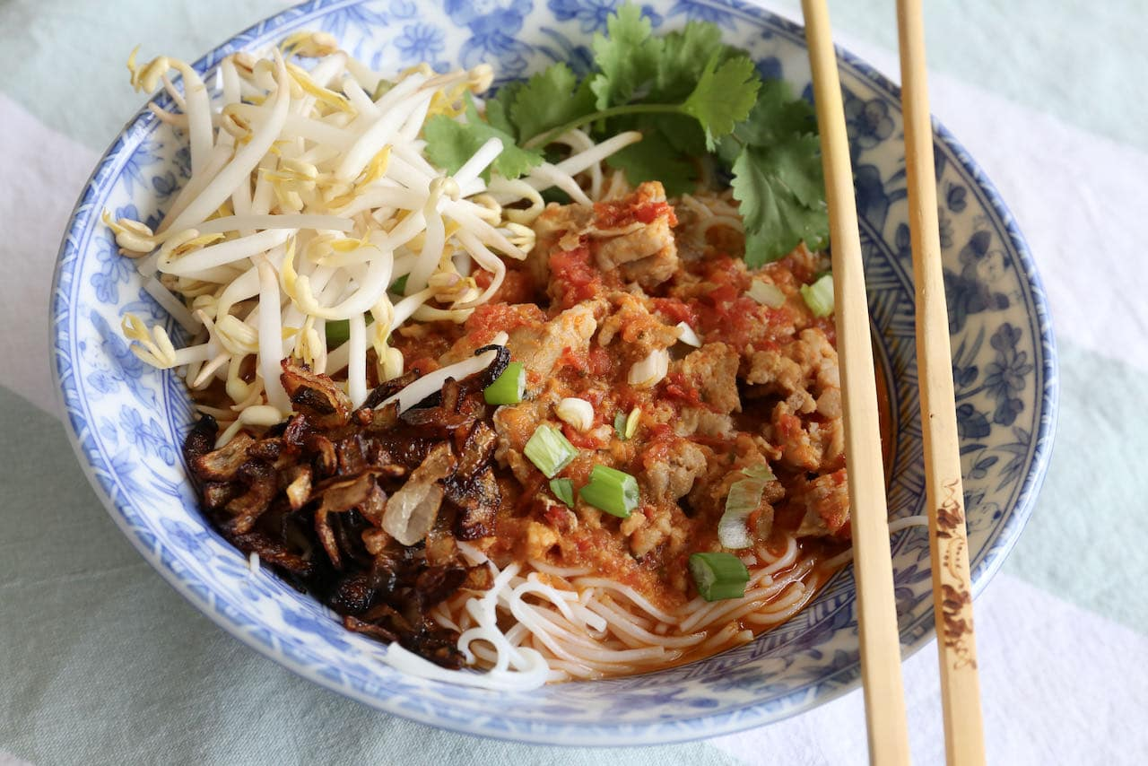 Serve Thai Pork Rib Soup with chopsticks and a spoon.