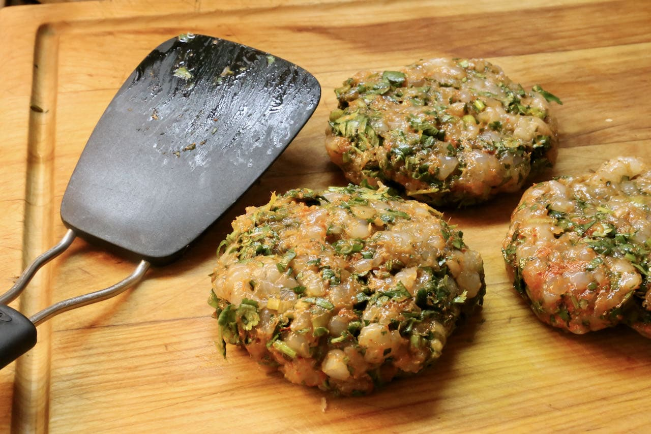Form each Prawn Burger into a plump pattie.