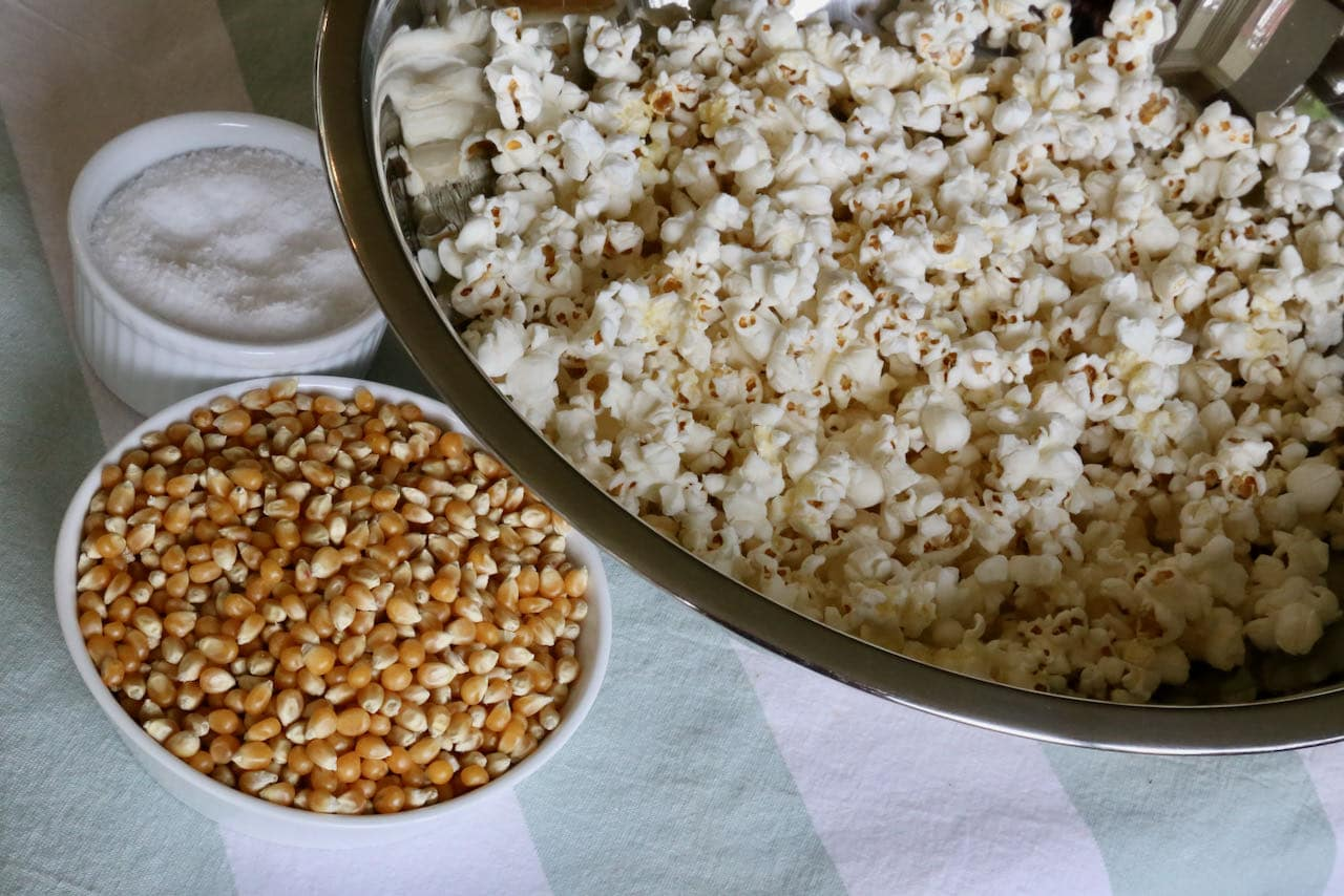 This simple Air Fryer Popcorn recipe features canola oil, salt and corn kernels.