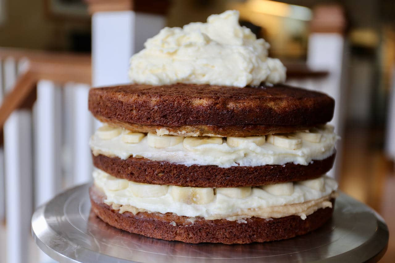 Our layered Banoffee cake is filled with homemade caramel sauce, cream cheese frosting and sliced bananas.