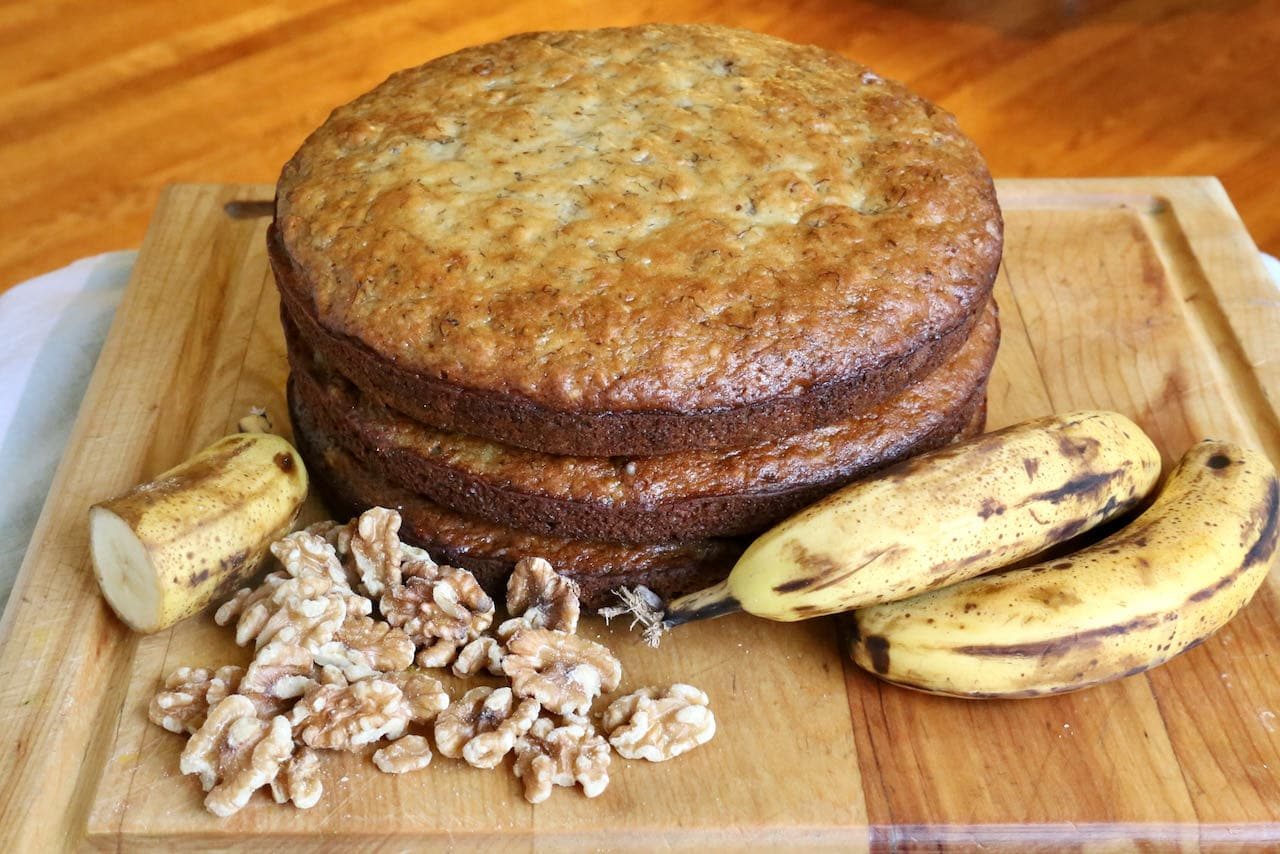 Our Banoffee Cake layers are made with ripe bananas and walnuts.