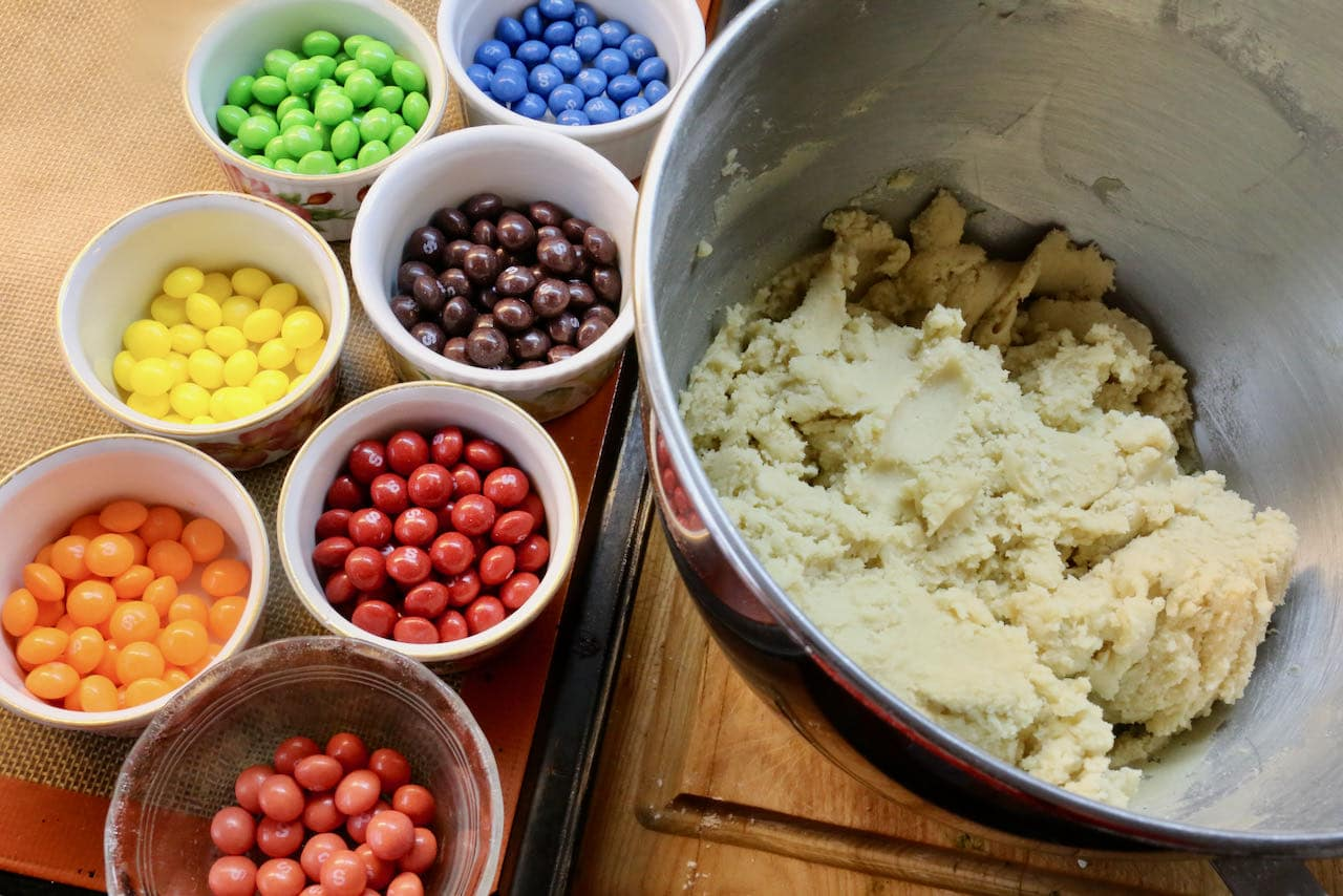 Organize Skittles by colour after preparing the sugar cookie dough.