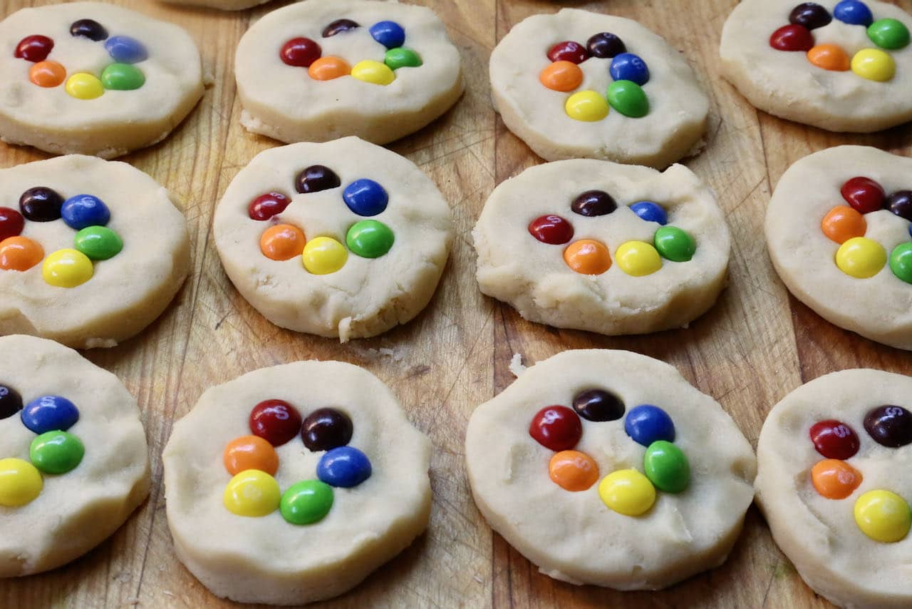 Use round cookie cutters to form the Gay Pride Cookies then press rainbow skittles into the centre in a circle.