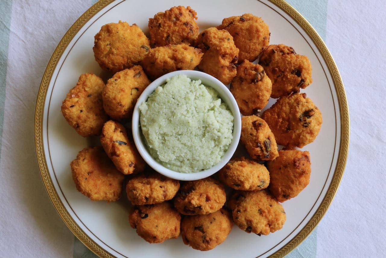 Serve Parippu Vada with spicy homemade coconut chutney.