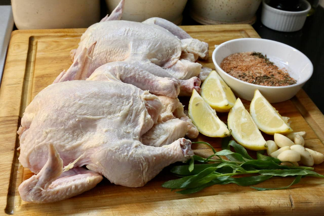 Slather Air Fried Cornish Hen with butter and stuff the cavity with tarragon, garlic and lemon wedges.