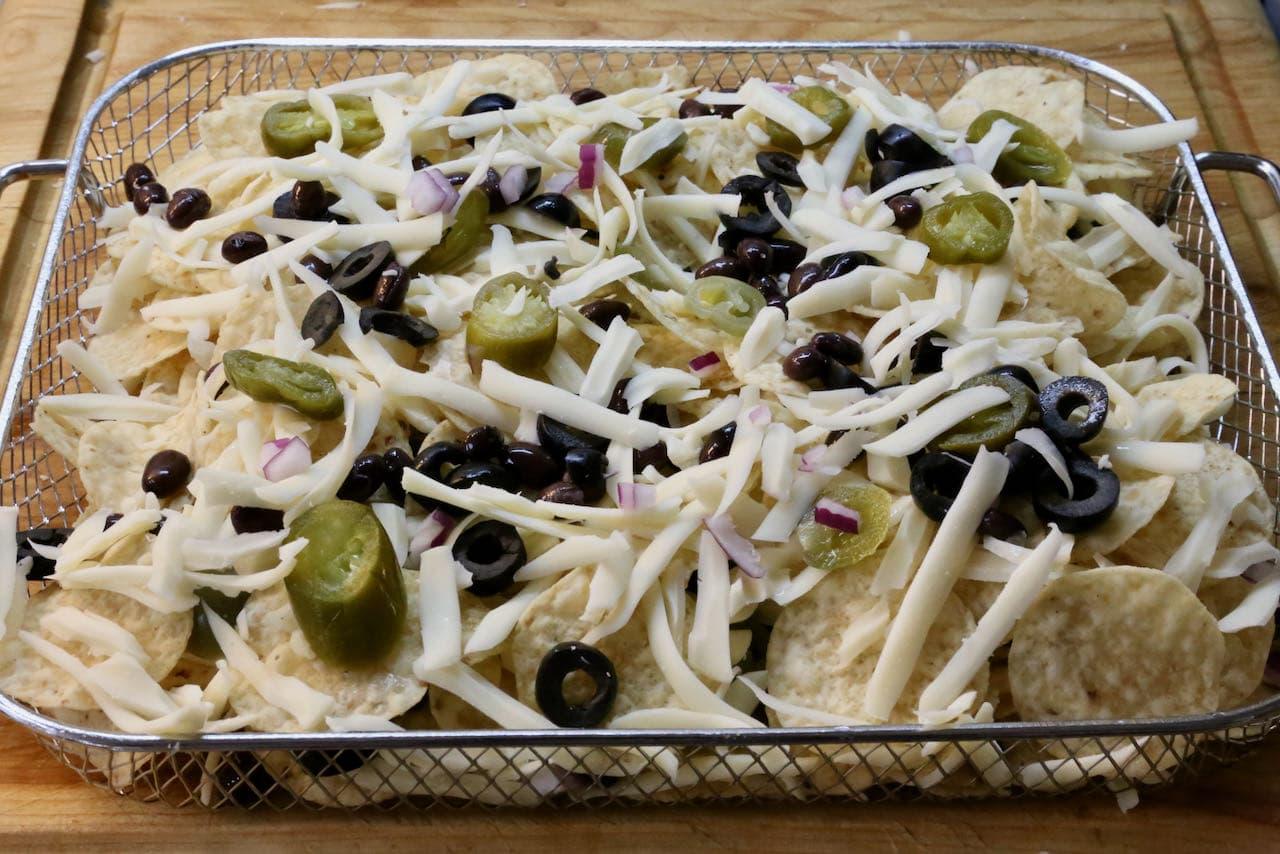 Layer our vegetarian Air Fryer Nachos in a basket.