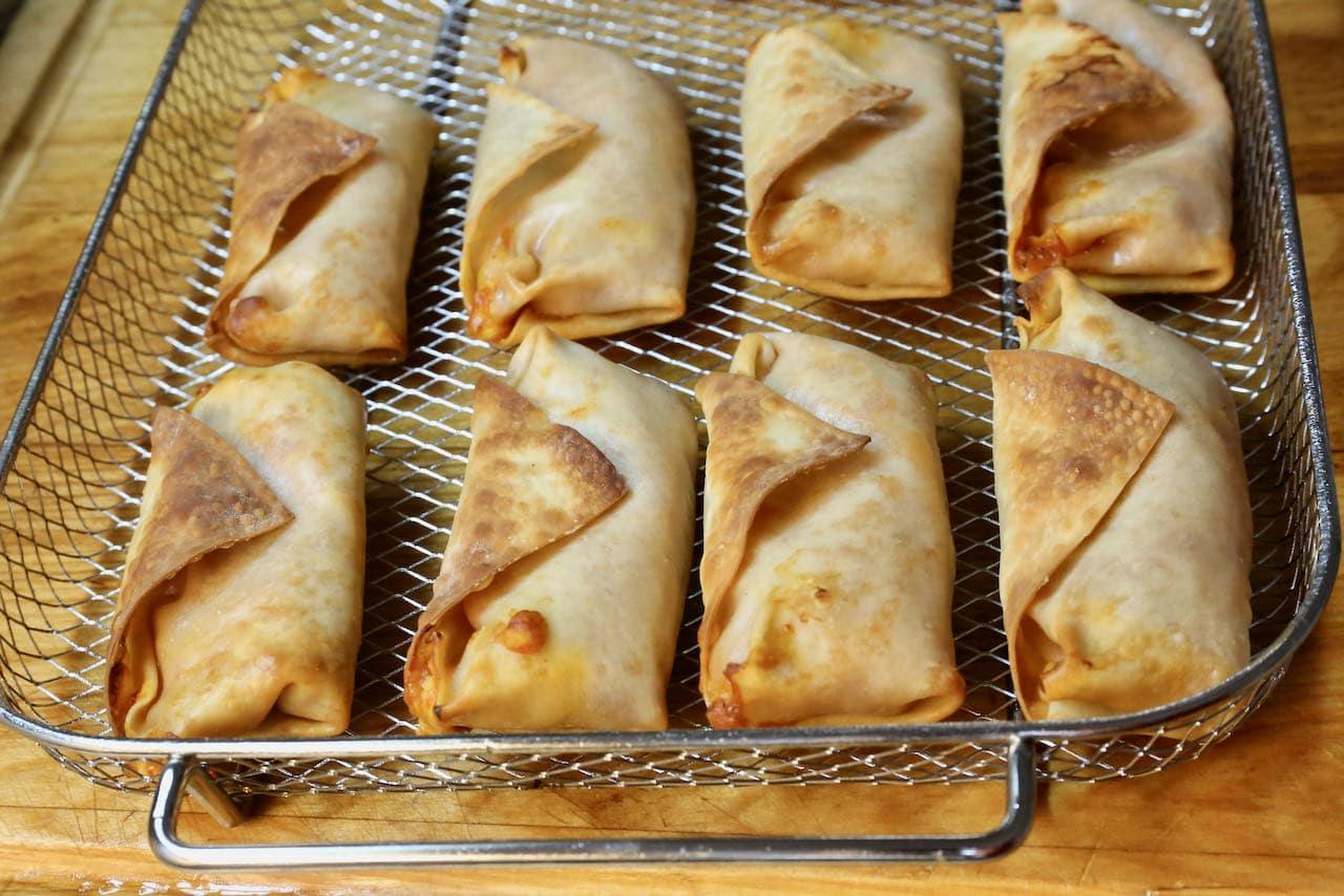 Cook Pizza Rolls in an air fryer basket until crispy.