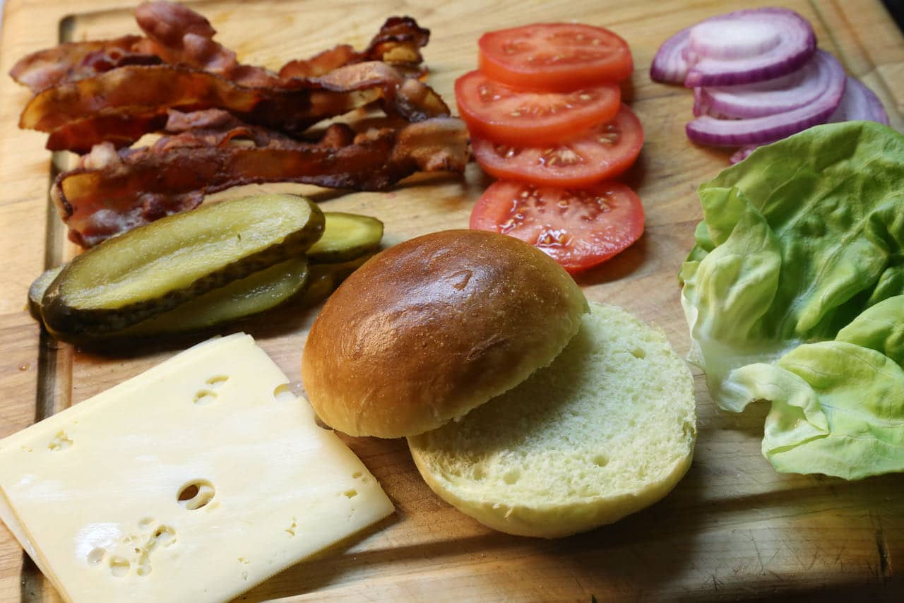 Our favourite burger toppings include cheese slices, pickles, crispy bacon, tomatoes, onions and lettuce.