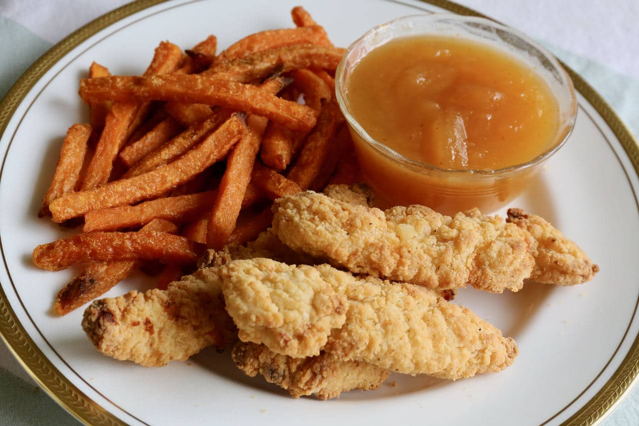 We love serving air fryer frozen chicken fingers with fries and plum sauce.
