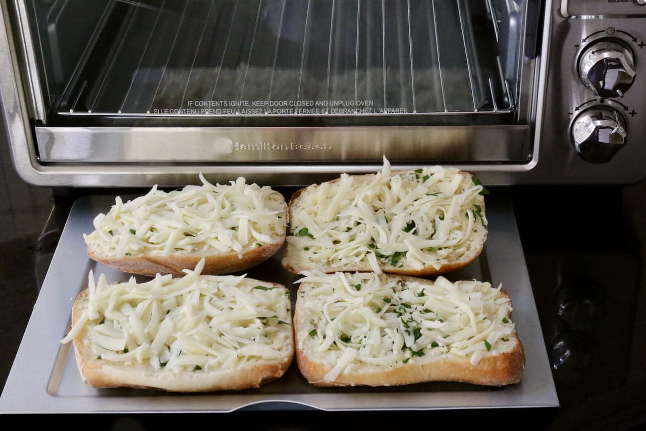 Place Cheesy Garlic Bread slices in Air Fryer and cook until mozzarella has melted.