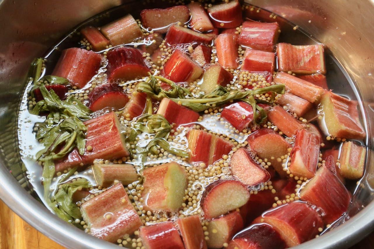 Let rhubarb steep in vinegar, tarragon and mustard seed pickling mixture.