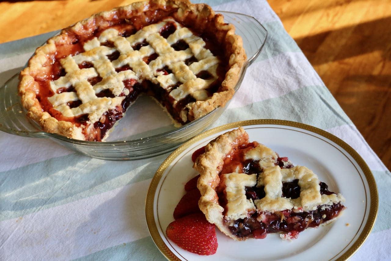 Serve Rhubarb Cherry Pie with ice cream and fresh berries.