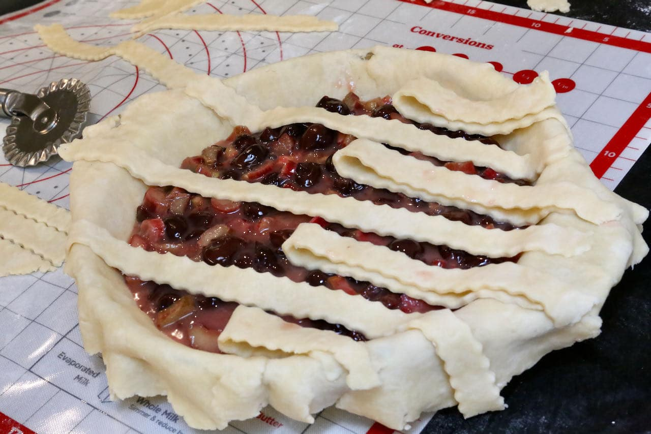 We suggest preparing our Rhubarb Cherry Pie crust using a traditional lattice method.