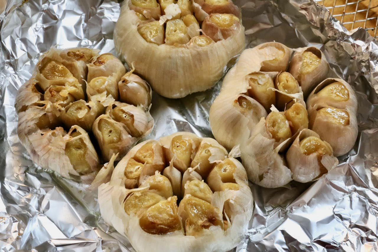 Air Fryer Roasted Garlic is finished cooking once the cloves have browned and are soft.