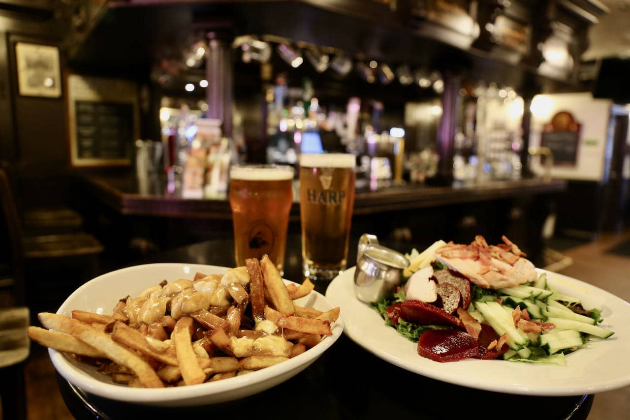 We suggest ordering a poutine at Charles Dickens Pub in Woodstock.