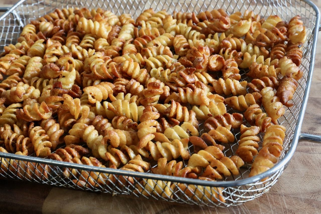You'll know our pasta chips recipe is finished cooking once your rotini is browned and crunchy.